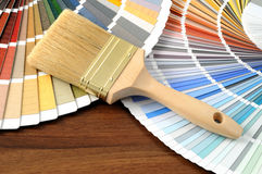 Color swatch on a table with a paintbrush Stock Photo