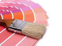 Color swatches. Paint brush on array of paint color swatches Royalty Free Stock Image