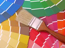 Color swatches. Paint brush on array of different paint color swatches Stock Photography