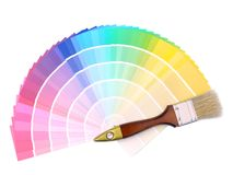 Color swatches. Paint brush on array of different paint color swatches Royalty Free Stock Photos