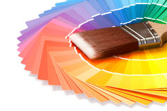 Color swatches. With paintbrush over white background Royalty Free Stock Photos