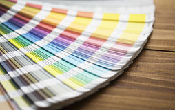 Color swatches. On a wooden table Stock Photography