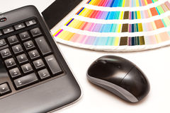 Color swatches and computer keyboard, mouse royalty free stock image