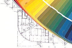 Color Swatches And Plans. Color samples catalog for selection with house plan on background Stock Photos