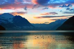 COLOR OF SWISS MOUNTAINS LAKE SUNSET, SWITZERLAND Stock Photo