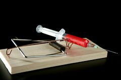 Color  syringe on mouse trap Royalty Free Stock Photos