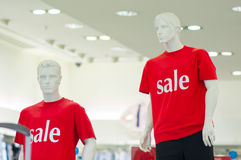 Color t-shirts with sale text on mannequins Stock Photography