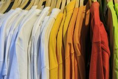 Color T shirts in a shop royalty free stock photos