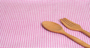 Color tablecloth, spoon, fork on  table Stock Image