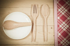 Color tablecloth, spoon, fork on  table Stock Photos