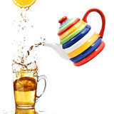 Color teapot with cup and lemon Stock Image