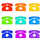 Color telephones. Old-fashioned telephones in rainbow colors Royalty Free Stock Images