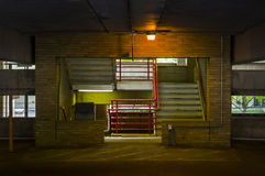 Color Temp. Prepared Three Ways. Parking garage stairwell with interesting, mysterious  lighting Stock Photo