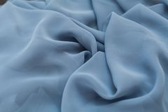 Color blue textil, silk fabric with pleats Royalty Free Stock Images