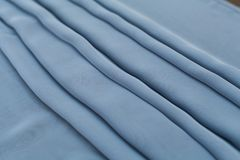 Color blue textil, silk fabric with pleats Royalty Free Stock Image
