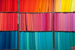 Color textiles. Arrange in gradient order on shelves Royalty Free Stock Photos