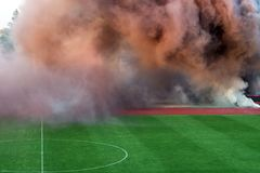 The color of thick smoke on the football field. royalty free stock image