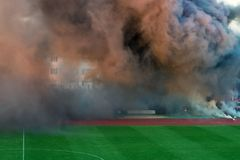 The color of thick smoke on the football field. royalty free stock photography