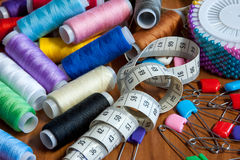 Color a thread, a measuring tape and pins Stock Photo