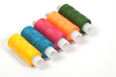 Color thread reels over white. Background stock images