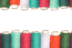 Color thread reels over white background. Thread isolated on a white background stock images