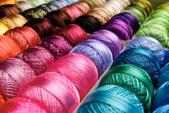 Color threads. Different color threads on rows in the store Stock Images