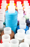 Color threads on spools Royalty Free Stock Images