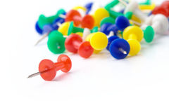 Color thumbtacks on white Stock Photos