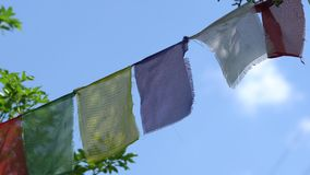 The color Tibetan prayful flags of Lungta flutter on wind. stock video footage
