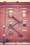Color toned building wall with fire escape stairs, USA Stock Photography