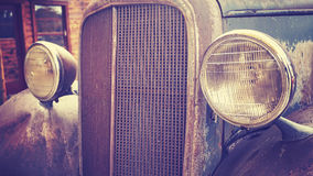 Color toned close up picture of an old rusty car headlamps. Royalty Free Stock Images