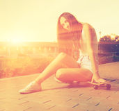 Color toned image og young girl sitting on her Royalty Free Stock Photo