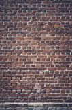 Color toned picture of a dark brick wall.  stock image