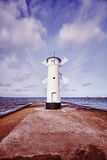 Color toned picture of old lighthouse in Swinoujscie, Poland Stock Image