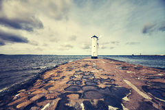Color toned picture of old lighthouse in Swinoujscie, Poland Stock Images