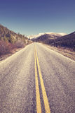 Color toned scenic mountain road, travel concept picture. Stock Image