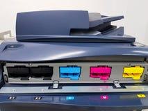 Color toners in the digital laser printer. (cyan, magenta, yellow, black) royalty free stock photos