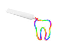 Color toothpaste. (creative concept): chromatic striped paste in the form of tooth is squeezed out from a tube as symbol of healthy teeth and high-quality Royalty Free Stock Images
