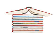 Color tower books arranged in house shape. Color tower books on white background arranged in house shape royalty free stock image