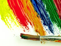Color traces and brush on a white sheet of paper. Stock Photography