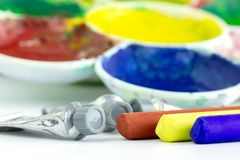 Color tubes and palettes placed on white background. royalty free stock images
