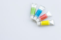 Color tubes on white Royalty Free Stock Photos