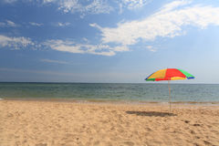 Color umbrella on the beach Stock Photography