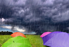 Color Umbrellas in Rainy Storm Clouds stock images