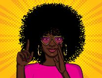 Color vector illustration in pop art style. African American girl shows thumb up. A girl with pink glasses wants to tell a secret. Character design for vector illustration