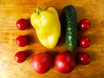 Color vegetables on a wooden background stock images