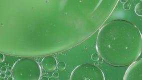 Color verde del extracto del fondo de la burbuja que fluye metrajes