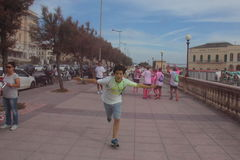 Color Vibe, people. Image of color vibe running. Italy, Livorno Stock Photo