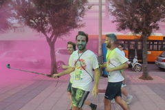 Color Vibe, people. Image of color vibe running. Italy, Livorno. Selfie Stock Photography