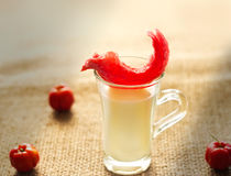 Color warm tone red flavored puffed fried on the top of glass milk Stock Photography